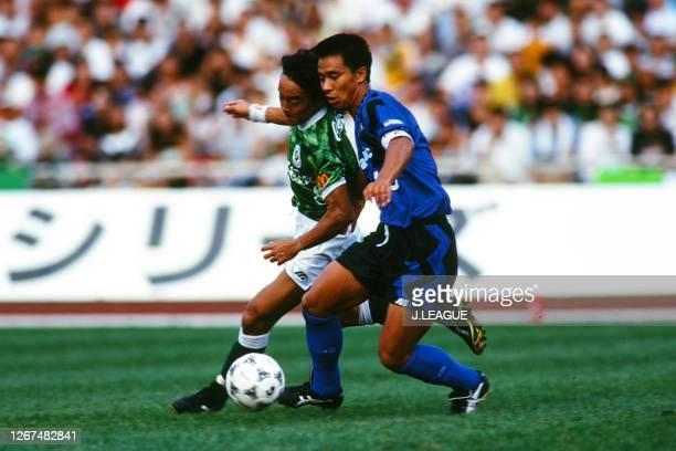 Hiromitsu Isogai of Gamba Osaka and Tsuyoshi Kitazawa of Verdy Kawasaki compete for the ball during the J.League Nicos Series match between Verdy...