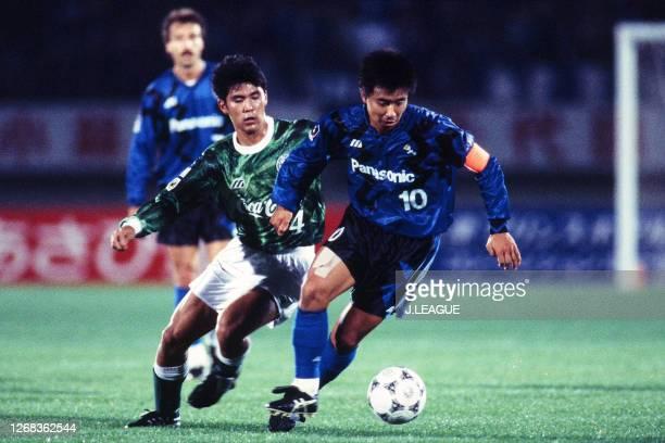 Hiromitsu Isogai of Gamba Osaka and Yuji Hironaga of Verdy Kawasaki compete for the ball during the JLeague Nicos Series match between Gamba Osaka...