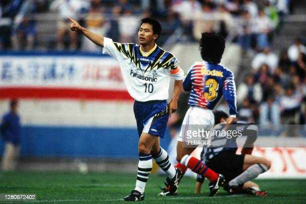 Hiromitsu Isogai of Gamba Osaka celebrates scoring a goal during the J.League Yamazaki Nabisco Cup Group A match between Yokohama Marinos and Gamba...