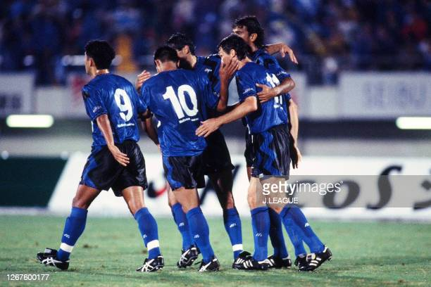 Hiromitsu Isogai of Gamba Osaka celebrates scoring his side's first goal with his team mates during the JLeague Nicos Series match between Gamba...
