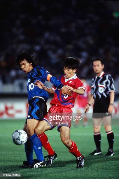 Hiromitsu Isogai of Gamba Osaka controls the ball under pressure of Naoki Soma of Kashima Antlers during the J.League Suntory Series match between...