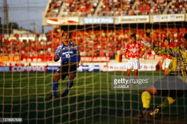Hiromitsu Isogai of Gamba Osaka converts the penalty to score his side's first goal during the J.League Nicos Series match between Urawa Red Diamonds...