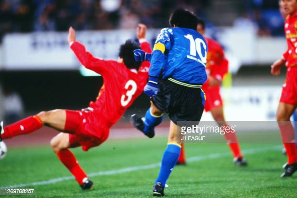 Hiromitsu Isogai of Gamba Osaka scores his side's third goal during the J.League Suntory Series match between Gamba Osaka and Nagoya Grampus Eight at...