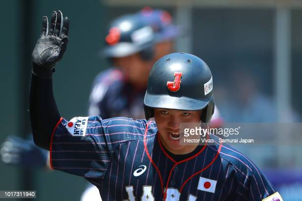 Hiromu Joshita of Japan celebrates after scoring in the 5th inning during the WBSC U15 World Cup Group B match between Japan and Netherlands at...