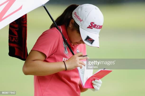 Hiromu Ono of Japan checks on the 18th hole during the final round of the Yupiteru The Shizuoka Shimbun SBS Ladies at the Shizuoka Country Hamaoka...
