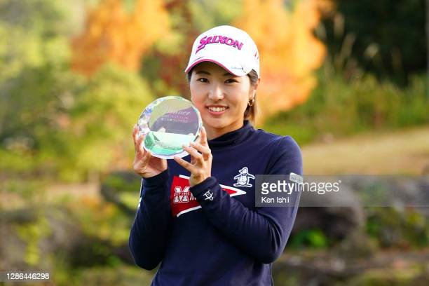 Hiromu Ono of Japan poses with the trophy after winning the tournament following the final round of the Castrol Ladies at the Fuji Ichihara Golf Club...