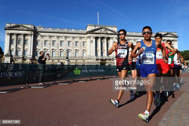 Hirooki Arai of Japan and Andres Chocho of Ecuador walk in front of Buckingham Palace in the Men's 50km Race Walk final during day ten of the 16th...