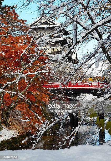 Hirosaki Castle is covered by snow on November 12 2013 in Hirosaki Aomori Japan A typical winter pressure pattern causes snowfall at Sea of Japan...