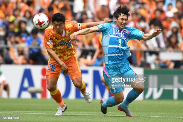 Hiroshi Futami of Shimizu SPulse and Cho Dong Geon of Sagan Tosu compete for the ball during the JLeague J1 match between Shimizu SPulse and Sagan...