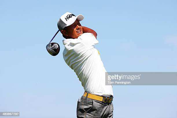 Hiroshi Iwata of Japan watches his tee shot on the 14th hole during the first round of the 2015 PGA Championship at Whistling Straits on August 13...