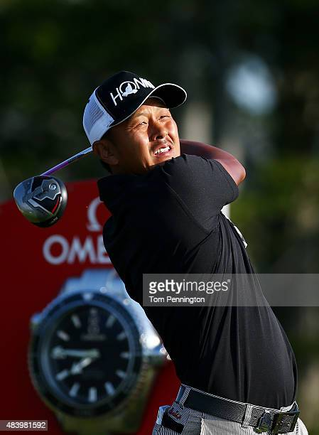 Hiroshi Iwata of Japan watches his tee shot on the first hole during the second round of the 2015 PGA Championship at Whistling Straits on August 14...