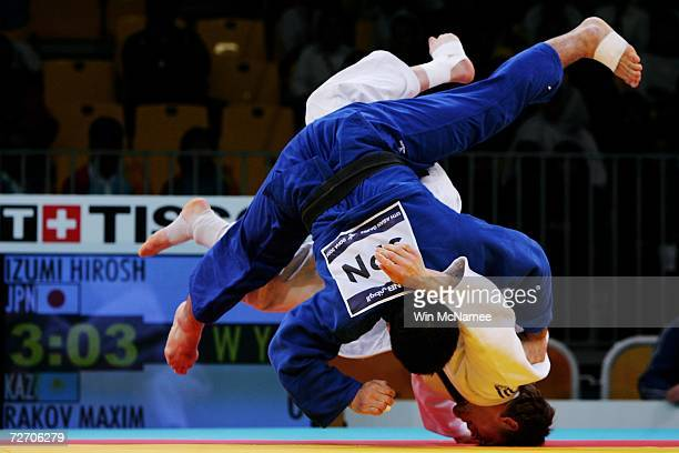 Hiroshi Izumi of Japan battles with Maxim Rakov of Kazakhstan during the Men's 90kg preliminary round at the 15th Asian Games Doha 2006 at the Qatar...