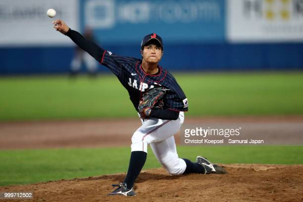 Hiroshi Kaino of Japan hits the ball in the ninth inning during the Haarlem Baseball Week game between Cuba and Japan at Pim Mulier Stadion on July...