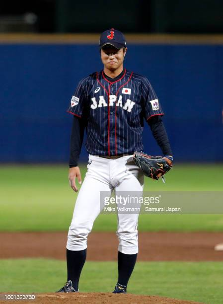 Hiroshi Kaino of Japan smiles for his last throw in the extension of the game during the Haarlem Baseball Week game between Netherlands and Japan at...