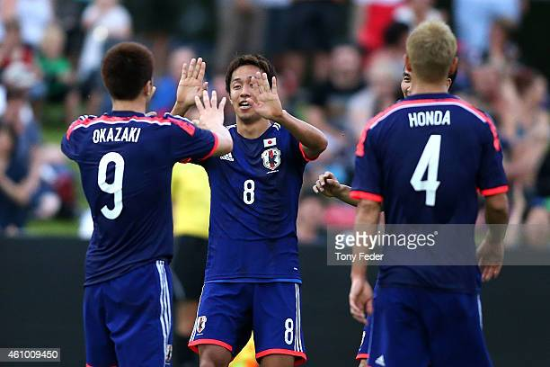 Hiroshi Kiyotake and Shinji Okazaki of Japan celebrate a goal during the Asian Cup practice match between Japan and Auckland City on January 4 2015...