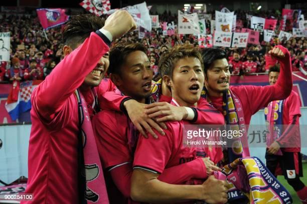 Hiroshi Kiyotake and Yuichiro Kakitani and Hotaru Yamaguchi of Cerezo Osaka gestures after the 97th All Japan Football Championship final between...