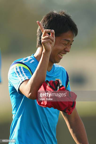 Hiroshi Kiyotake laughs as he takes part in a drill during a Japan training session at the Japan national team base camp at the Spa Sport Resort on...