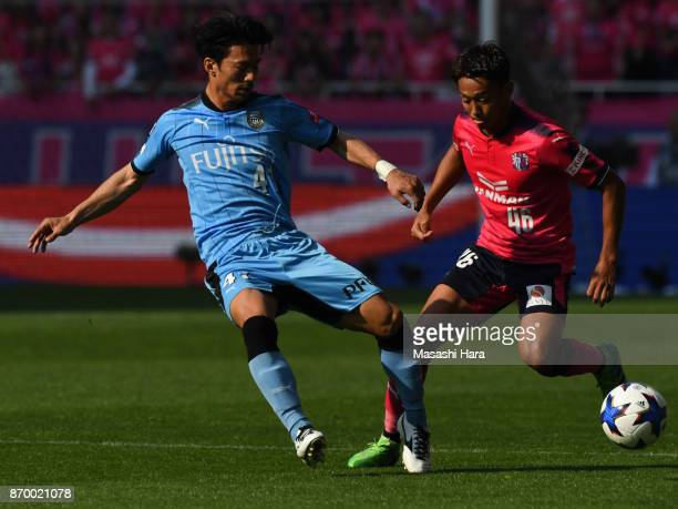 Hiroshi Kiyotake of Cerezo Osaka and Akihiro Ienaga of Kawasaki Frontale compete for the ball during the JLeague Levain Cup final match between...