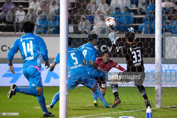 Hiroshi Kiyotake of Cerezo Osaka heads to score his side's second goal past Shuichi Gonda of Sagan Tosu during the JLeague J1 match between Sagan...