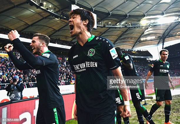 Hiroshi Kiyotake of Hannover 96 celebrates with fans as Christian Schulz score their second goal during the Bundesliga match between VfB Stuttgart...