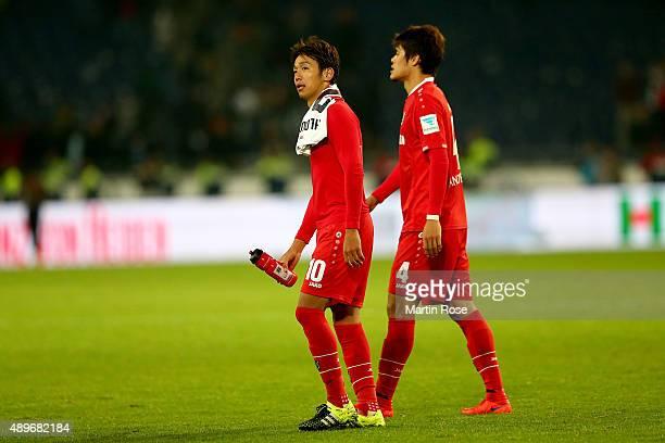 Hiroshi Kiyotake of Hannover and team mate Hiroki Sakai look dejected after the Bundesliga match between Hannover 96 and VfB Stuttgart at HDIArena on...