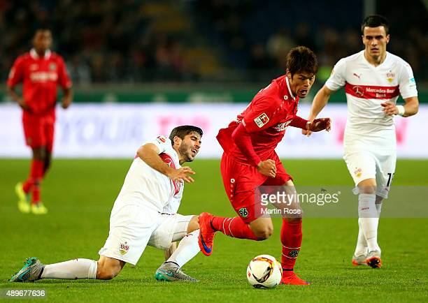 Hiroshi Kiyotake of Hannover battles for the ball with Zapata Insua of Stuttgart during the Bundesliga match between Hannover 96 and VfB Stuttgart at...