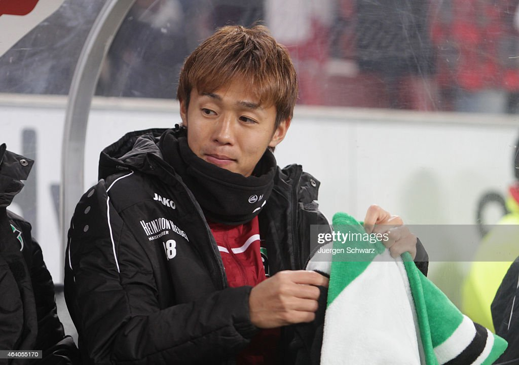 Hiroshi Kiyotake of Hannover sits on the bench at the Bundesliga match between 1. FC Koeln and Hannover 96 at RheinEnergieStadion on February 21, 2015 in Cologne, Germany.