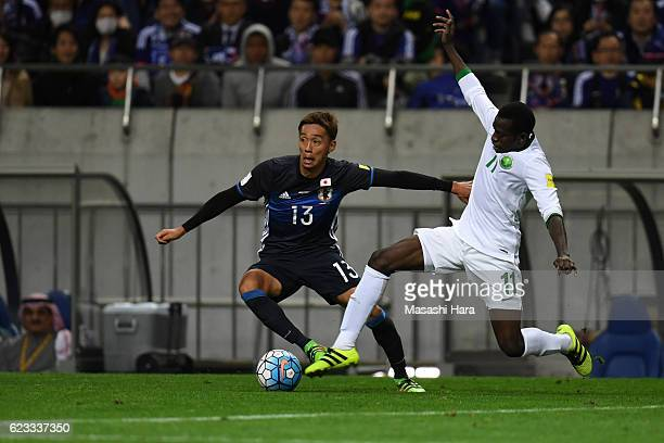Hiroshi Kiyotake of Japan and Abdulmalek Al Khaibri of Saudi Arabia compete for the ball during the 2018 FIFA World Cup Qualifier match between Japan...