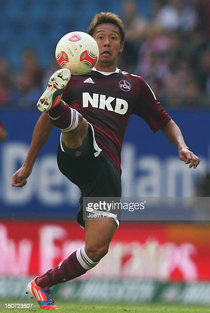 Hiroshi Kiyotake of Nuernber controls the ball during the Bundesliga match between Hamburger SV and 1 FC Nuernberg at Imtech Arena on August 25 2012...