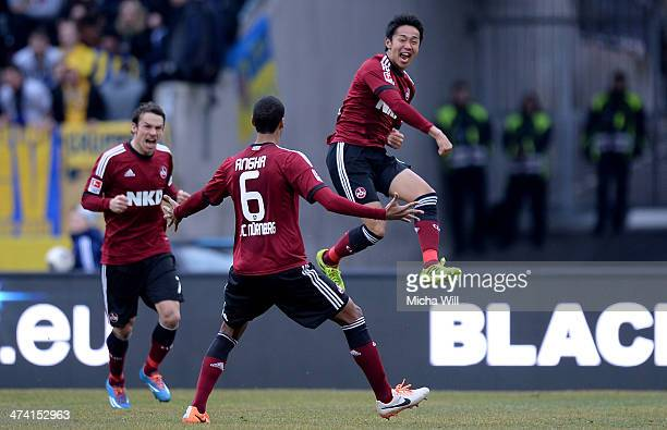 Hiroshi Kiyotake of Nuernberg celebrates with teammates after scoring his team's first goal during the Bundesliga match between 1 FC Nuernberg and...