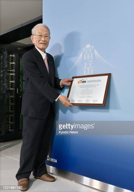 Hiroshi Matsumoto, president of Japan's state-backed Riken research institute, poses for a photo in front of new supercomputer Fugaku in Kobe on June...