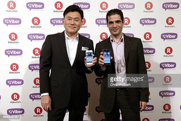 Hiroshi Mikitani chairman and chief executive officer of Rakuten Inc and Talmon Marco chief executive officer of Viber pose for photos after...