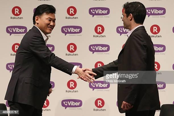 Hiroshi Mikitani chairman and chief executive officer of Rakuten Inc greets Talmon Marco chief executive officer of Viber on stage after announcing...