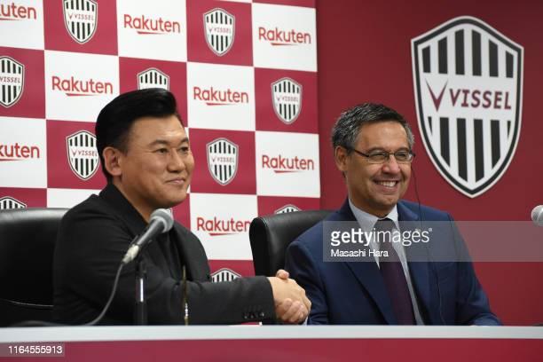 Hiroshi Mikitani of Vissel Kobe and Josep Maria Bartomeu of FC Barcelona shake hands during a press conference before the preseason friendly match...