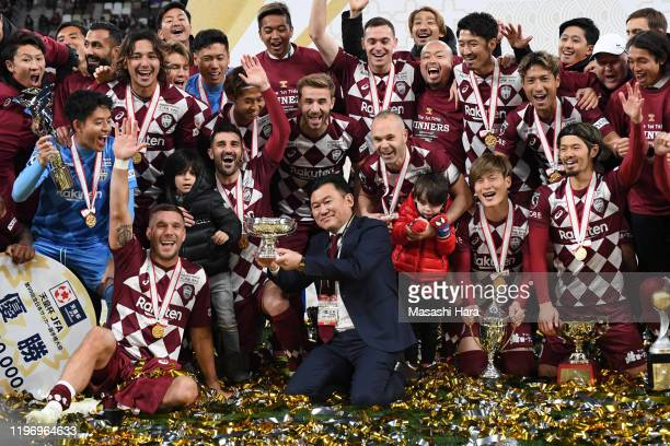 Hiroshi Mikitani of Vissel Kobe holds the trophy after the 99th Emperor's Cup final between Vissel Kobe and Kashima Antlers at the National Stadium...