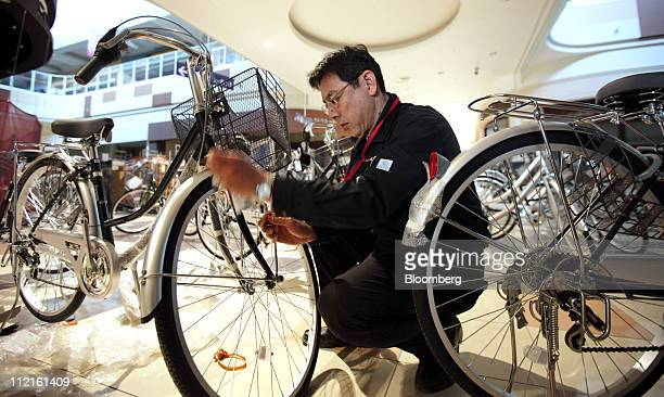 Hiroshi Okumura the shop manager for Aeon Co's Ishinomaki shopping mall prepares bicycles for a sale in the backyard of the shopping mall in...