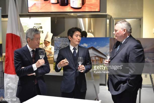 Hiroshi Sakurai and son Kazuhiro the chairman and president of Asahi Shuzo Co respectively speak with Culinary Institute of America President Tim...