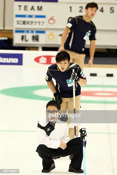 Hiroshi Sato of Sapporo instructs teammates as Kosuke Morozumi of SC Karuizawa looks on during the Game Two of the Curing Japan Qualifying Tournament...