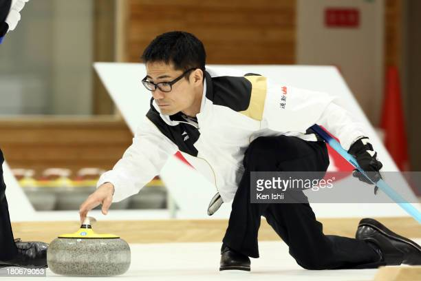 Hiroshi Sato of Sapporo throws a stone during Game Two of the Curling Japan Qualifying Tournament between SC Karuizawa and Sapporo at Dohgin Curling...