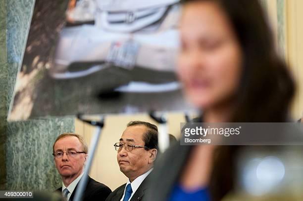 Hiroshi Shimizu senior vice president of global quality assurance at Takata Corp center listens as Stepanie Erdman right testifies at a Senate...