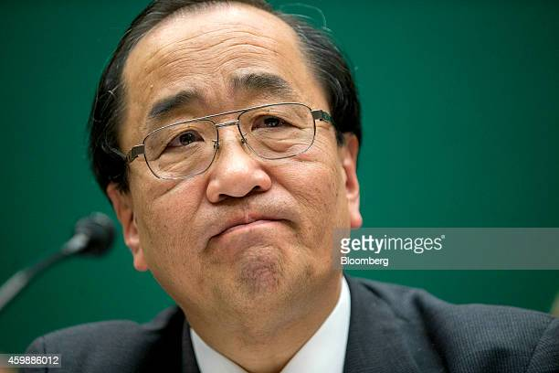 Hiroshi Shimizu senior vice president of global quality assurance at Takata Corp listens during a House Energy and Commerce Subcommittee hearing in...