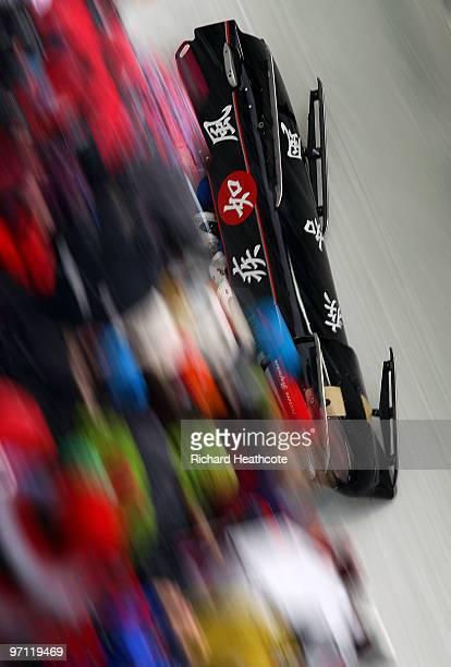 Hiroshi Suzuki Masaru Miyauchi Shinji Doigawa and Ryuichi Kobayashi of Japan crash in Japan 1 at turn 16 during the fourman bobsleigh heat 2 on day...