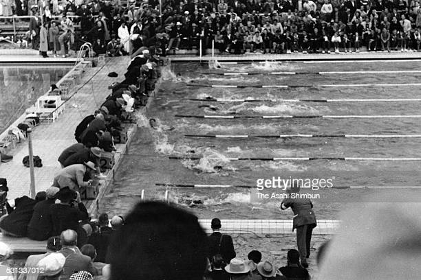 Hiroshi Suzuki of Japan finishes to win the silver in the Men's 100m Freestyle final during the Helsinki Summer Olympic Games at the Swimming Stadium...