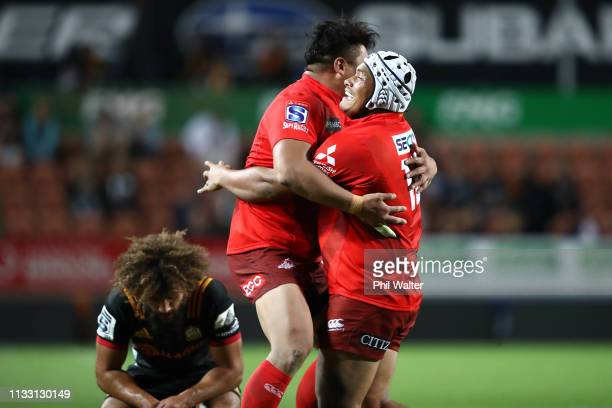 Hiroshi Yamashita and Asaeli Valu of the Sunwolves celebrate following the round three Super Rugby match between the Chiefs and the Sunwolves at FMG...