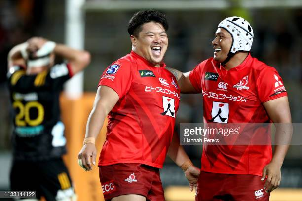 Hiroshi Yamashita of the Sunwolves celebrates with Asaeli Ai Valu of the Sunwolves after winning the round three Super Rugby match between the Chiefs...