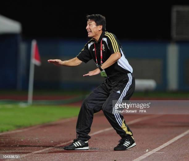 Hiroshi Yoshida coach of Japan shouts instructions during the FIFA U17 Women's World Cup Semi Final match between North Korea and Japan at the Ato...
