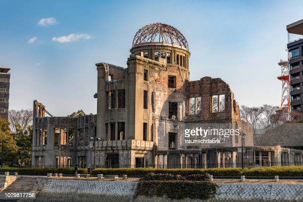 hiroshima a-bomb dome in golden afternoon light - hiroshima peace memorial stock photos and pictures
