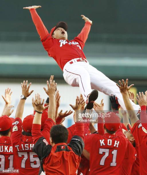 Hiroshima Carp manager Koichi Ogata is tossed into the air by players of his team after the Carp clinch their second straight Central League...