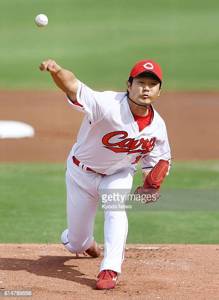 Hiroshima Carp starter Akitake Okada pitches against the DeNA BayStars in Game 4 of the Central League Climax Series Final Stage at Mazda Stadium in...