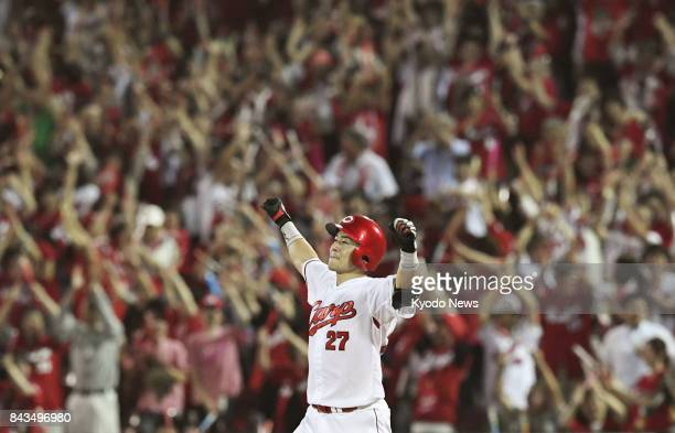 Hiroshima Carp's Tsubasa Aizawa acknowledges the crowd after hitting a walkoff single in the 11th inning to give his team a 43 win over the Hanshin...